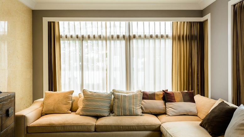 Sheer Curtains on windows in a living room